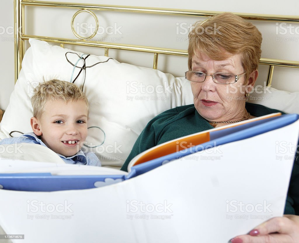 grandmother and grandson reading royalty-free stock photo