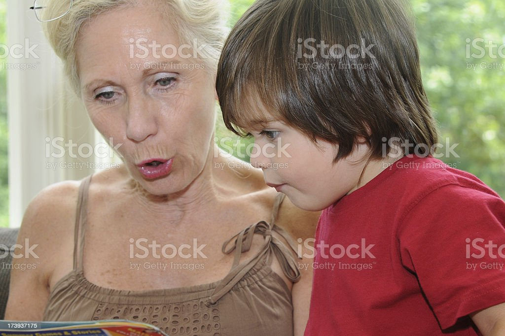 Grandmother and grandson reading. royalty-free stock photo