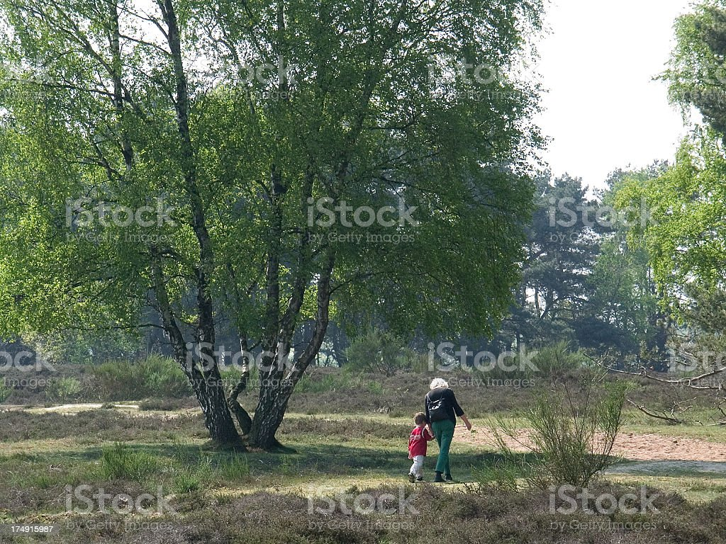 Grandmother and grandson walking royalty-free stock photo