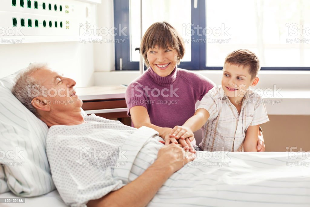 Grandmother and grandson with grandfather at hospital stock photo