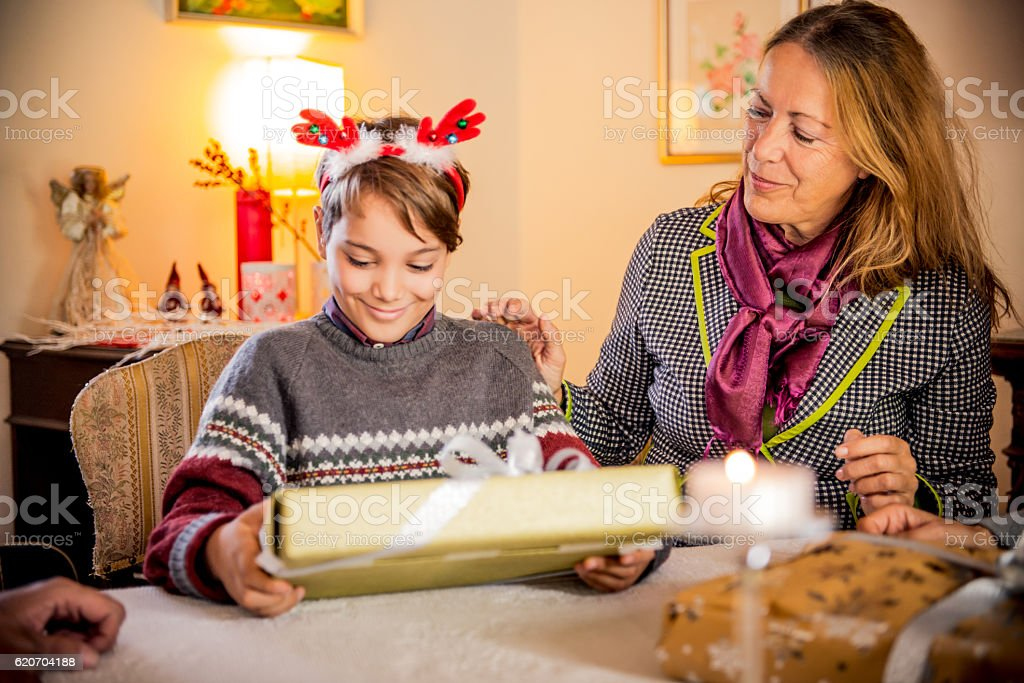 Grandmother and Grandson Wrapping Christmas Presents stock photo