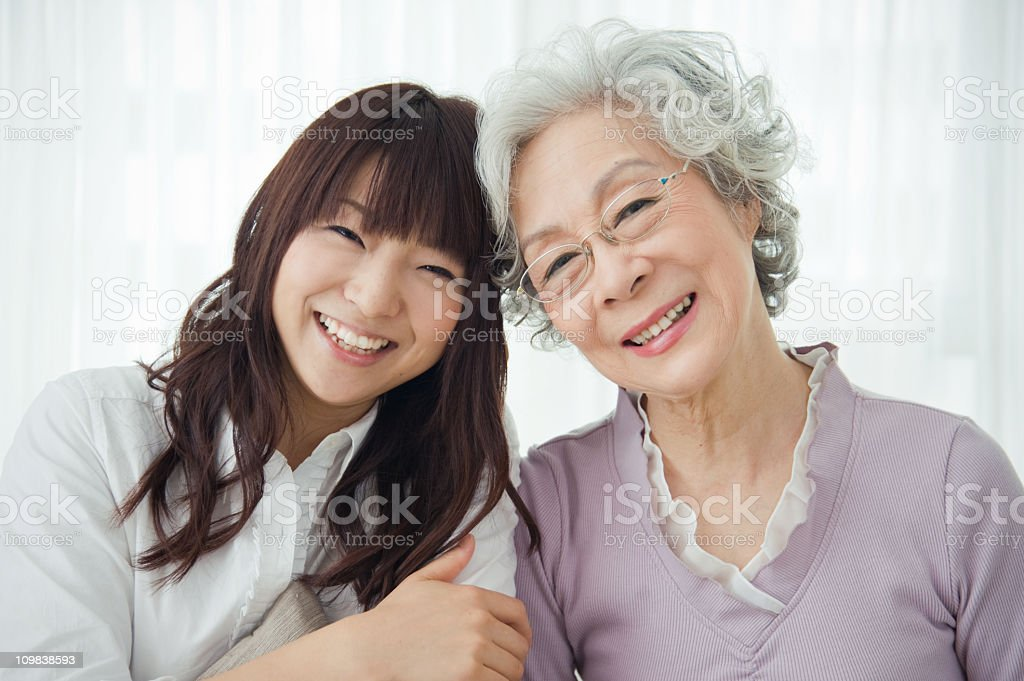 Grandmother and her granddaughter showing two generations royalty-free stock photo