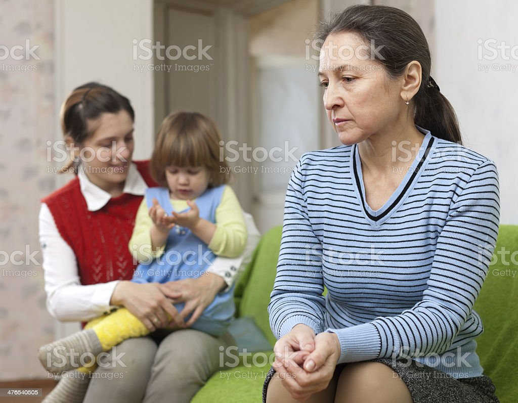 grandmother and mother with baby having quarrel royalty-free stock photo