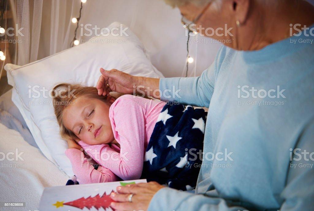 Grandmother caressing granddaughter's face stock photo