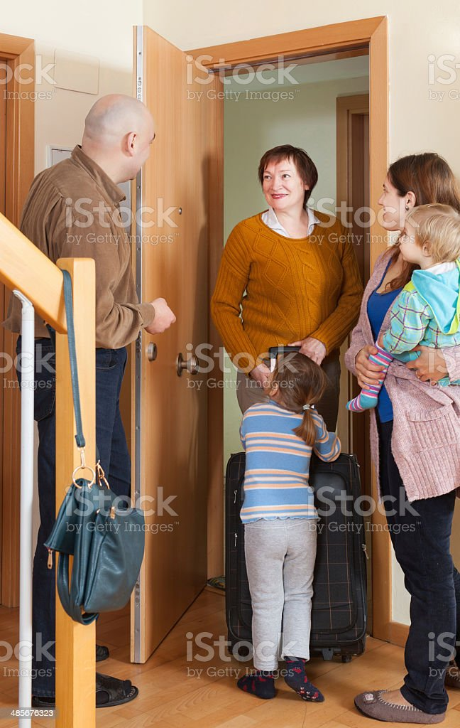 grandmother coming to family  home stock photo