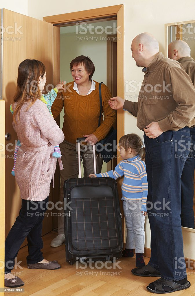 Grandmother coming to family stock photo