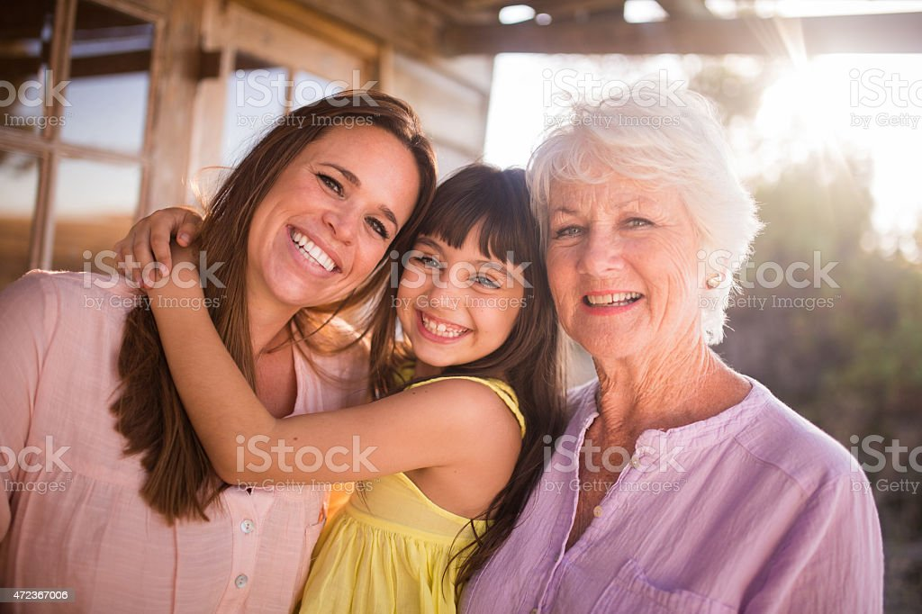 Grandmother, daughter and granddaughter posing for a portrait stock photo
