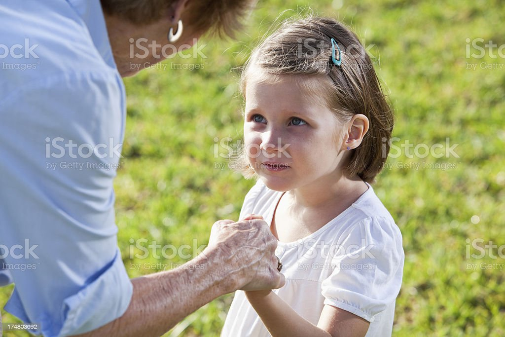 Grandmother disciplining little girl stock photo