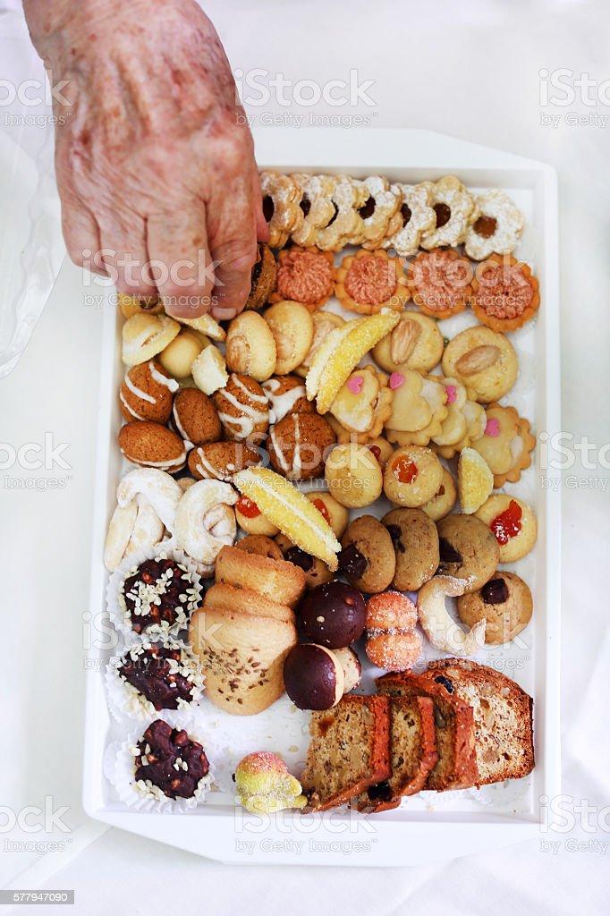 Grandmother eating homemade cookies at teatime break stock photo