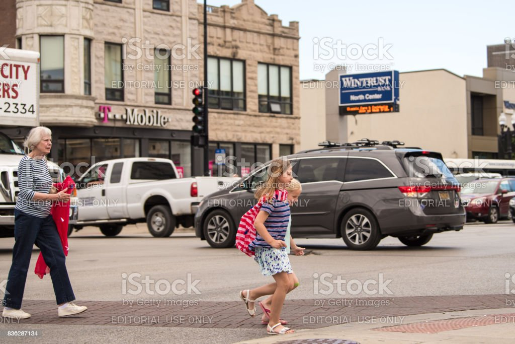A grandmother follows her granddaughters in North Center, Chicago stock photo