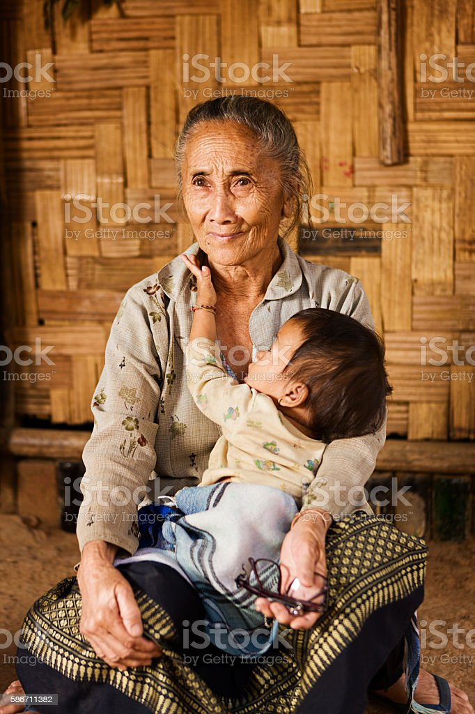 Grandmother from the hill tribe holding her granddaughter stock photo