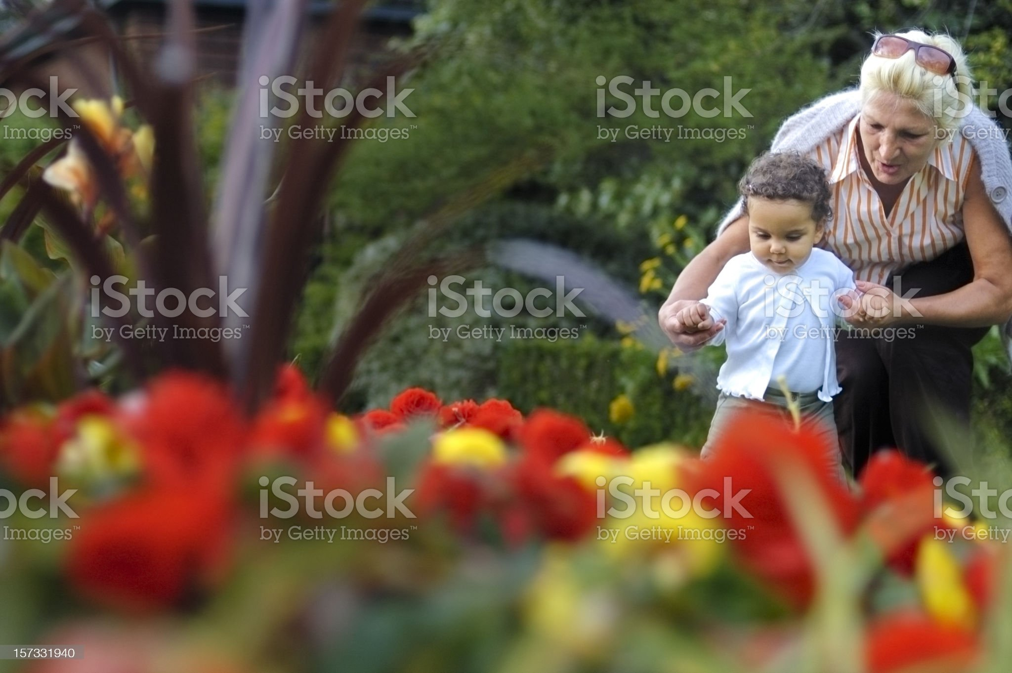 Grandmother Helping her Granddaughter with First Steps ( serie) royalty-free stock photo