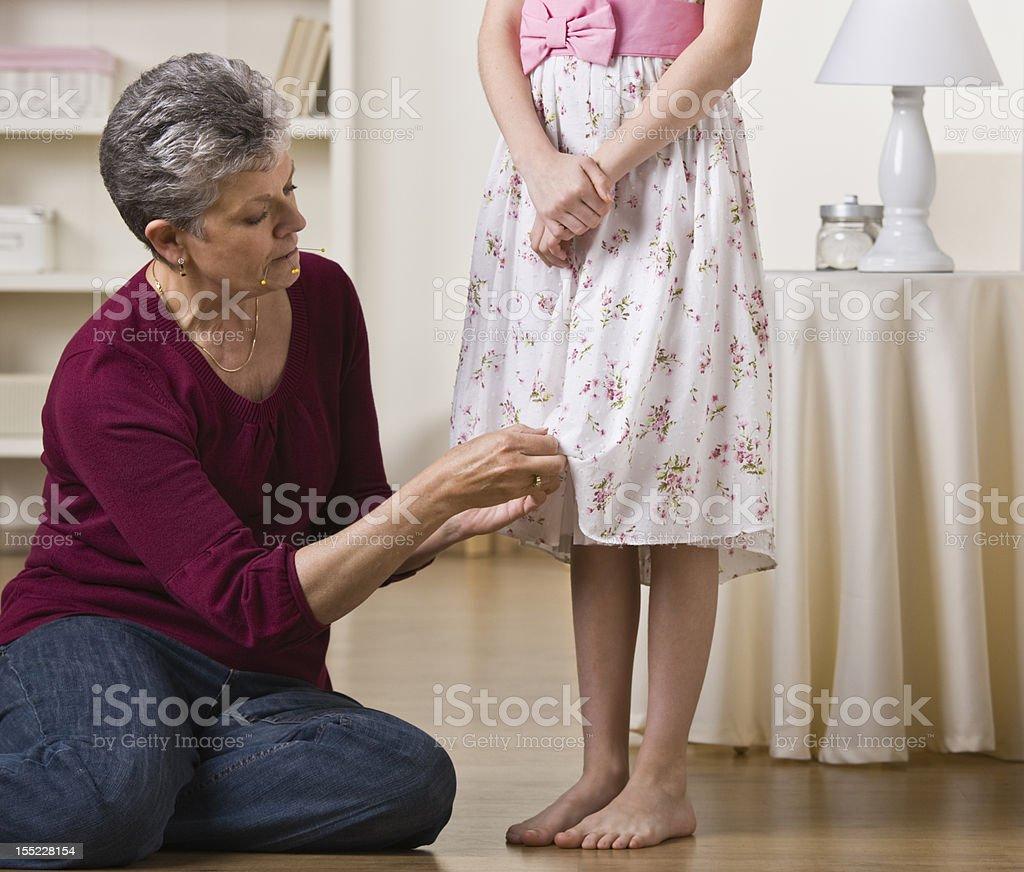 Grandmother Hemming Girl's Skirt stock photo