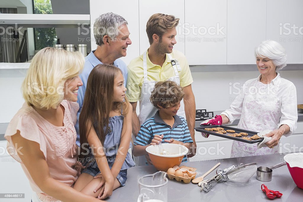 Grandmother holding a baking tray with cookies royalty-free stock photo