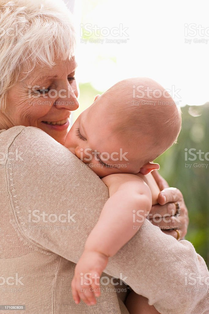 Grandmother holding baby royalty-free stock photo