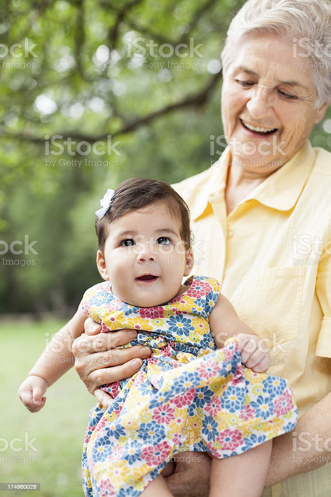 Grandmother holding her baby granddaughter royalty-free stock photo