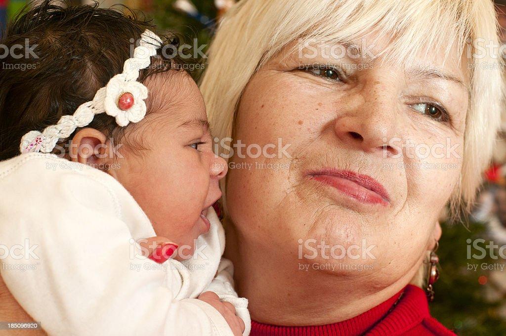 Grandmother Holding Her Granddaughter Baby Newborn royalty-free stock photo