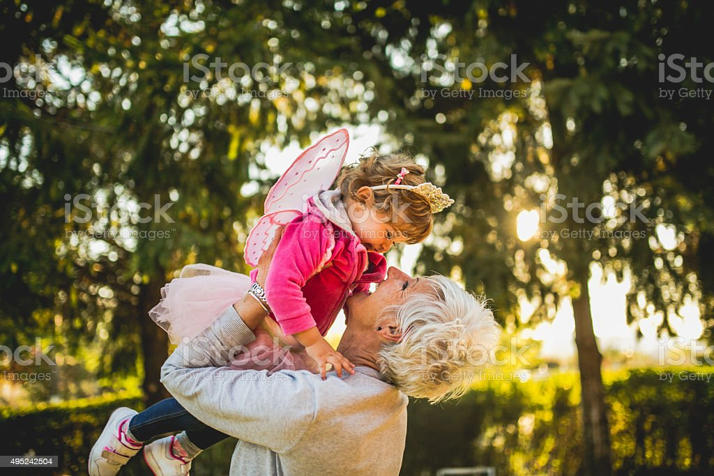 Grandmother holding her granddaughter stock photo
