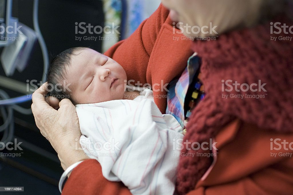 Grandmother holds newborn at the hospital royalty-free stock photo