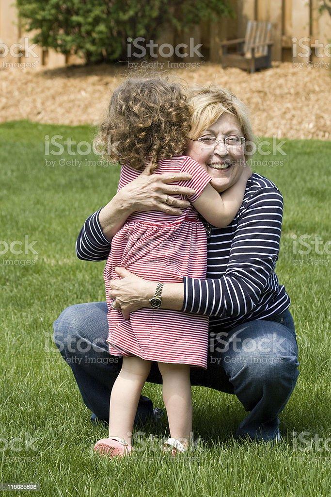 Grandmother hugging granddaughter royalty-free stock photo
