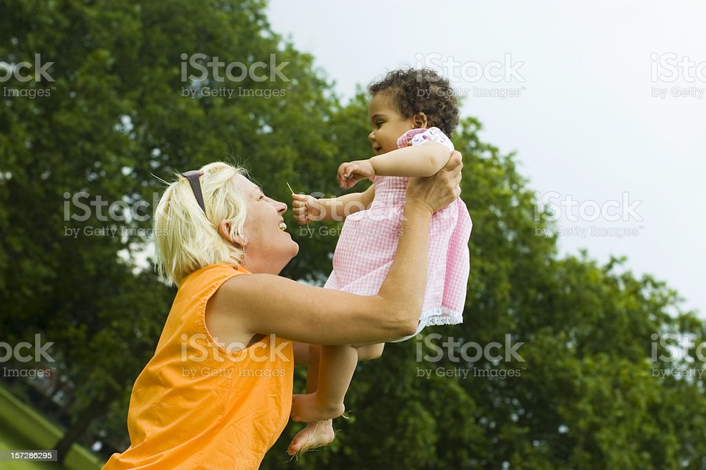 Grandmother Lifting her Granddaughter up( serie) royalty-free stock photo