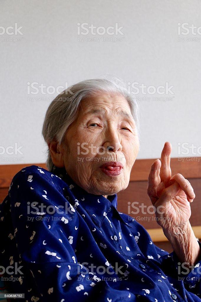 Grandmother peace sign stock photo