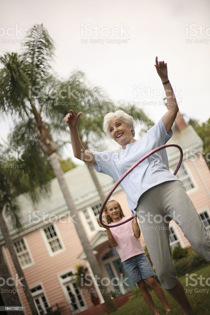 Grandmother playing with granddaughter royalty-free stock photo