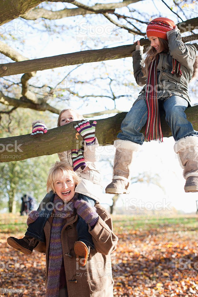 Grandmother playing with granddaughters outdoors royalty-free stock photo