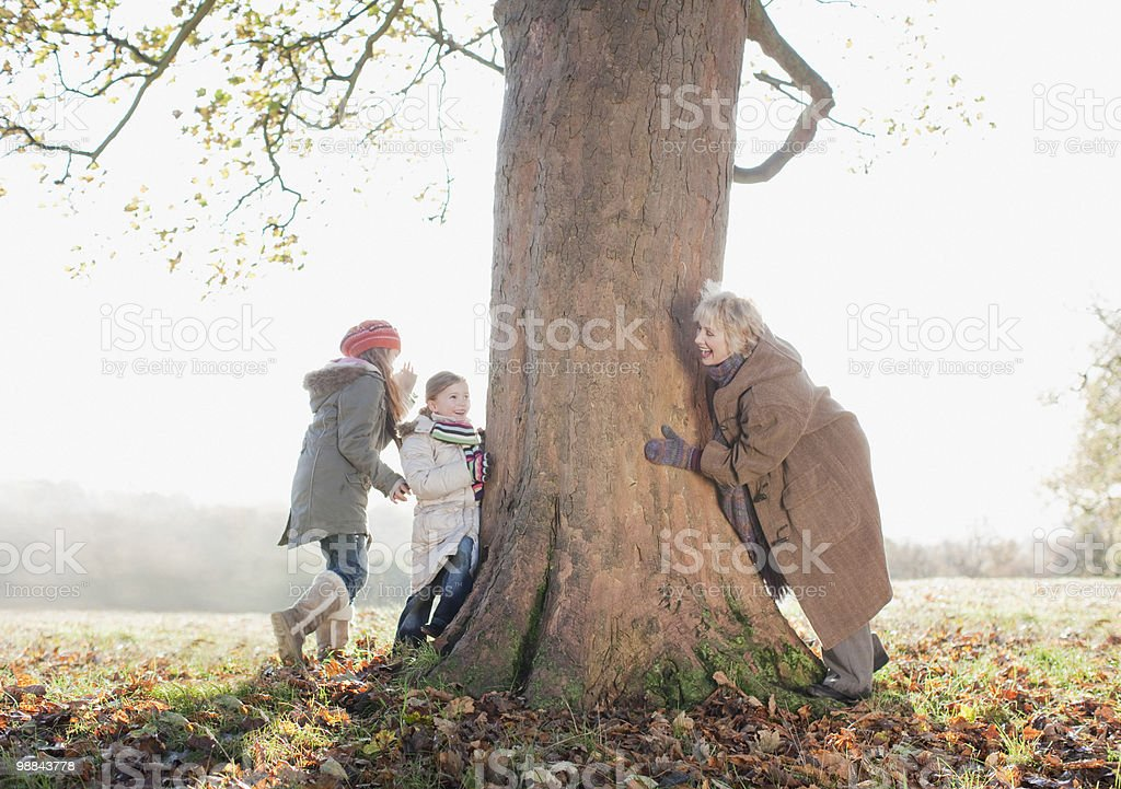 Grandmother playing with granddaughters outdoors stock photo