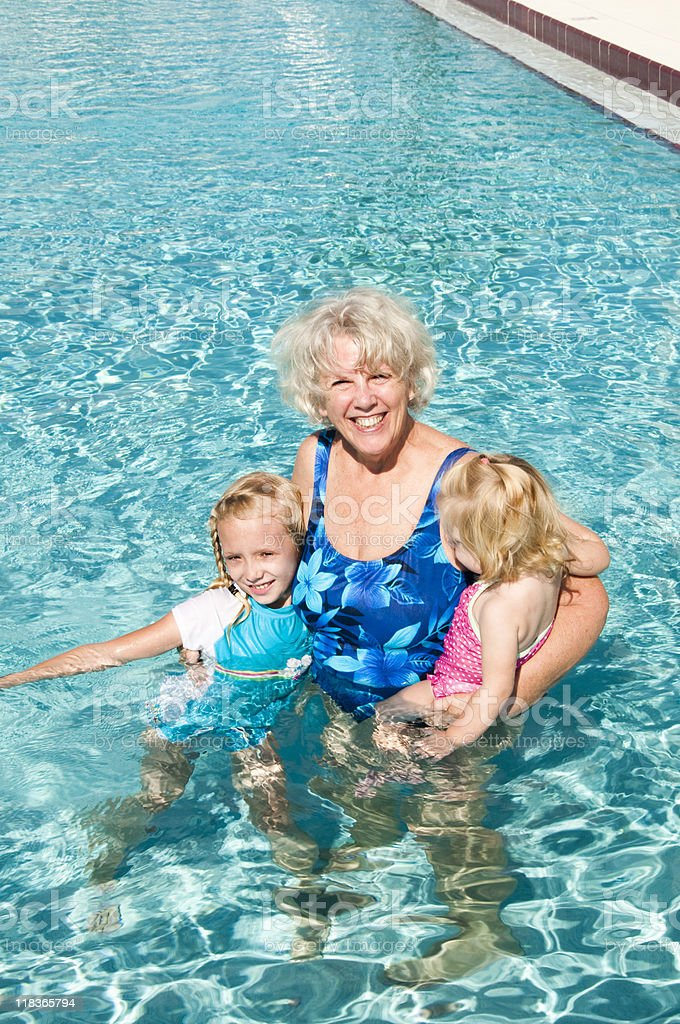 grandmother playing with grandkids royalty-free stock photo