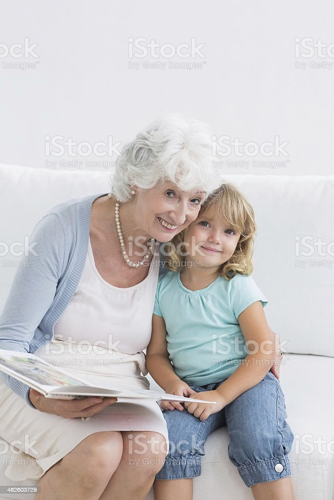 Grandmother reading a storybook to her granddaughter royalty-free stock photo