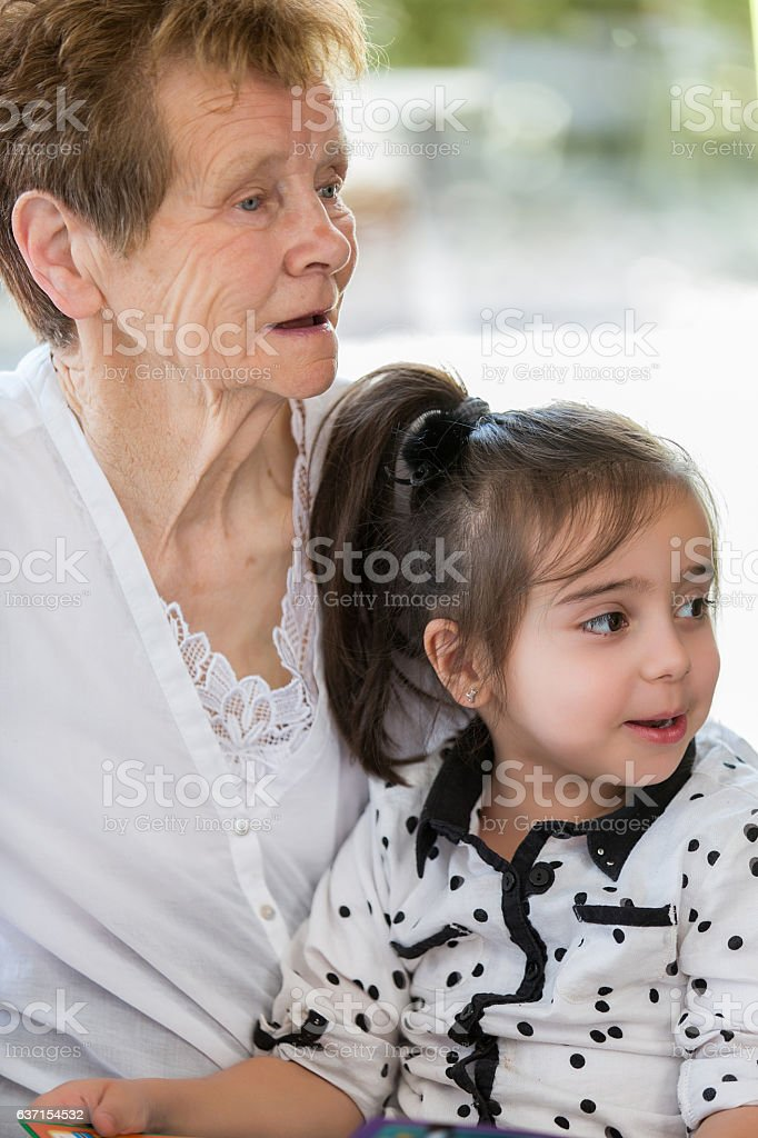 Grandmother reading story stock photo