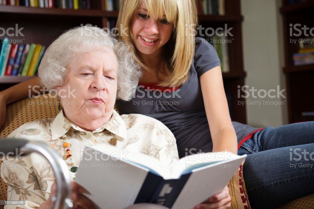 Grandmother Reading to Granddaughter royalty-free stock photo