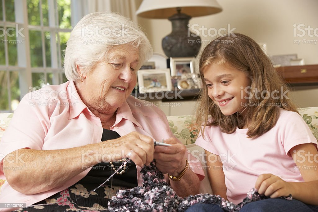 Grandmother Showing Granddaughter How To Knit At Home royalty-free stock photo