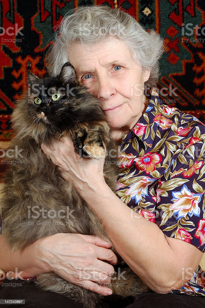 grandmother sitting with cat on her hands royalty-free stock photo