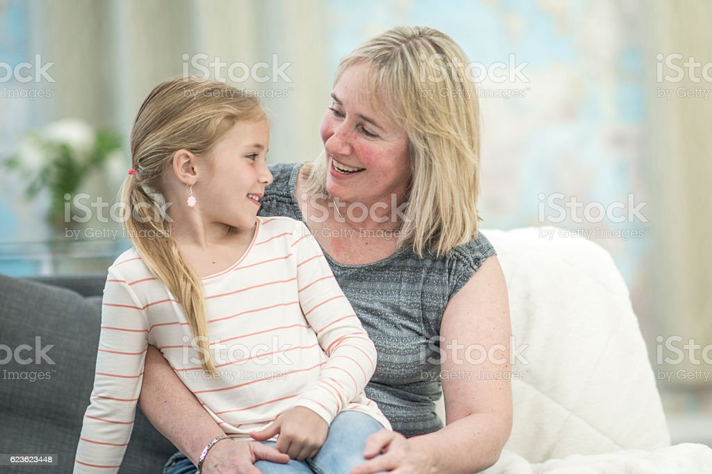 Grandmother Sitting with Her Granddaughter stock photo