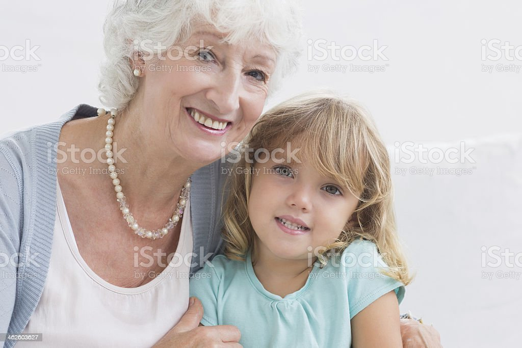 Grandmother smiling with her granddaughter royalty-free stock photo