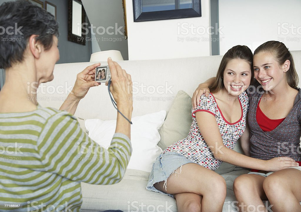 A grandmother taking a picture of her granddaughters royalty-free stock photo