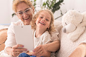 Grandmother taking  selfie with child