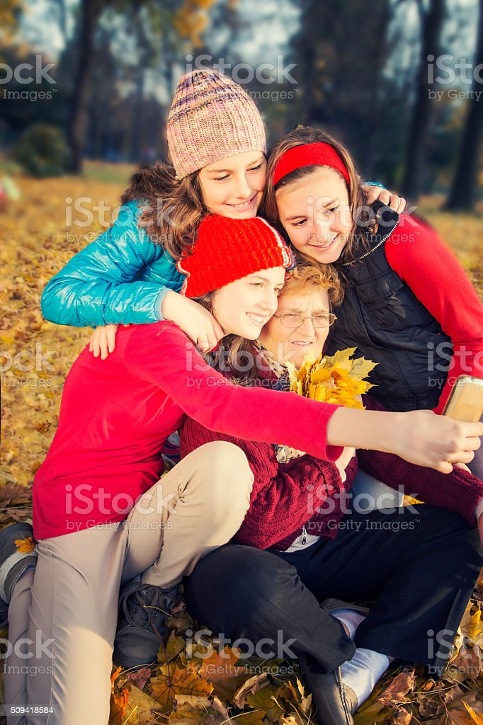 Grandmother taking selfie with her granddaughters royalty-free stock photo