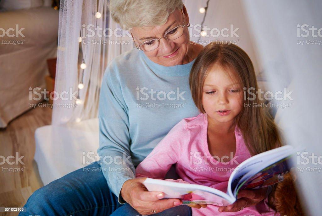 Grandmother teach granddaughter how spelling stock photo