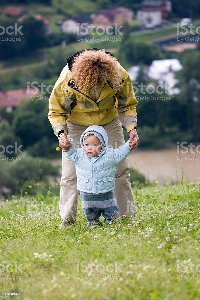 Grandmother teaches walking her grandson royalty-free stock photo