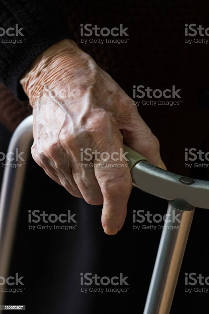 Grandmother uses a walker stock photo