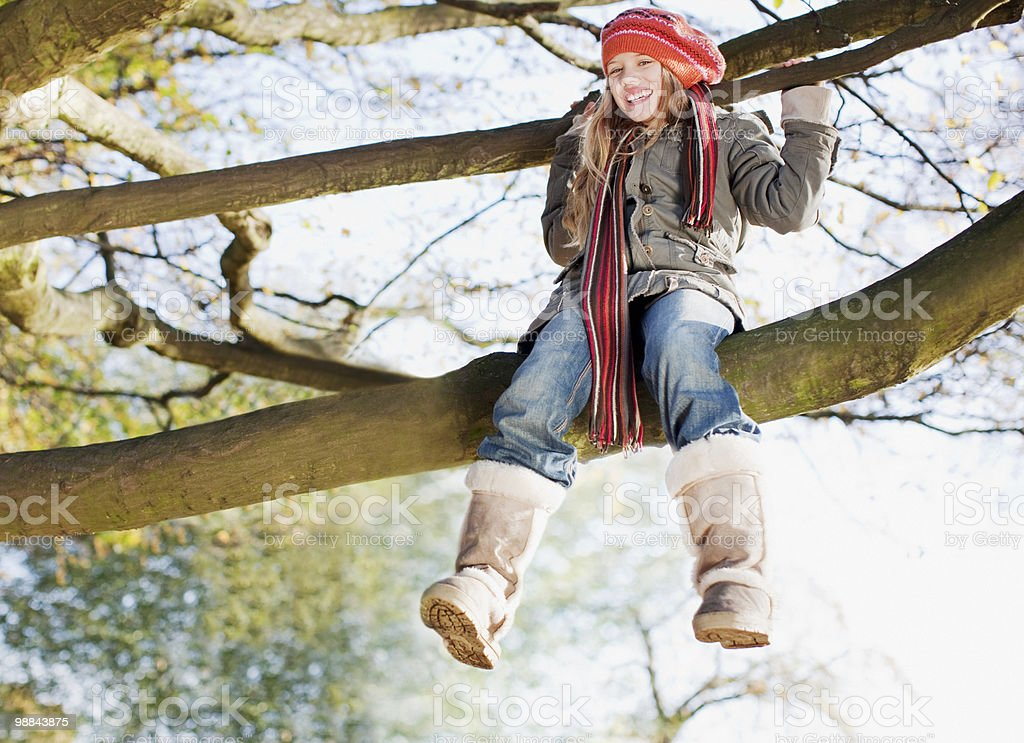 Grandmother watching granddaughters climb tree royalty-free stock photo