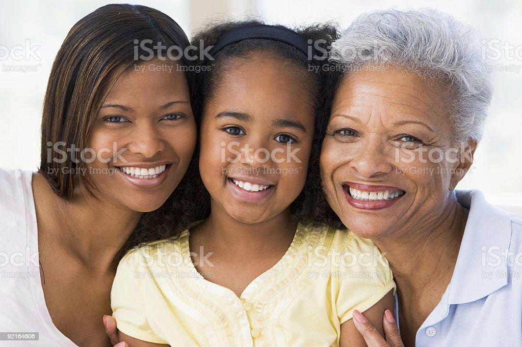 Grandmother with adult daughter and grandchild stock photo