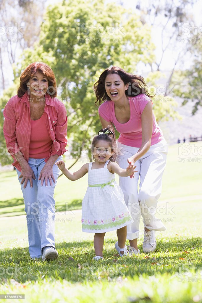 Grandmother with adult daughter and granddaughter in park royalty-free stock photo