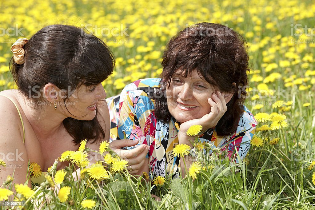 Grandmother with daughter in outdoor. royalty-free stock photo