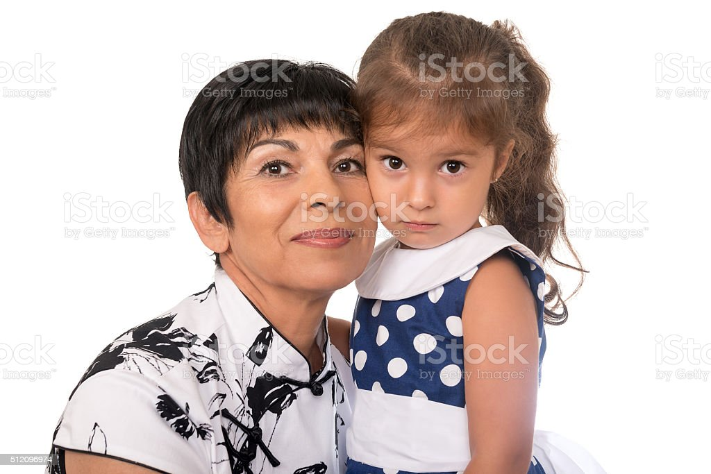 Grandmother with grandchild - senior woman holding her granddaughter. Isolated stock photo