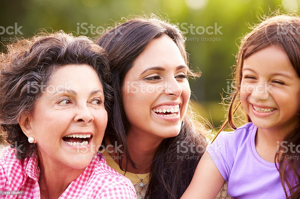 Grandmother With Granddaughter And Mother In Park stock photo