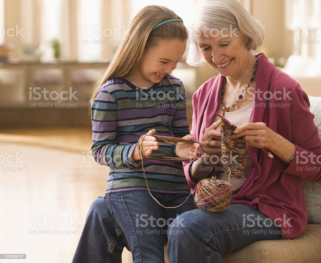 Grandmother with granddaughter getting ready to knit stock photo